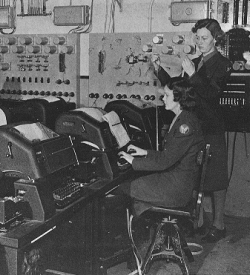 WACs operating teletype machines